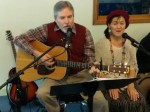 Dave and Dana Waters sing Christmas songs at party